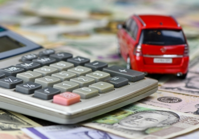 calculator-and-red-toy-car-on-a-variety-of-national-currency-banknotes