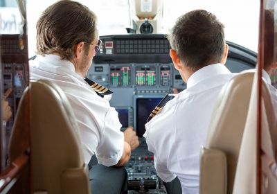 pilot-and-copilot-in-private-jet-cockpit-PC86DRY